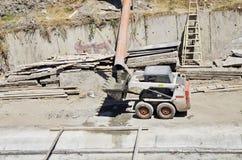 Grävskopa Bobcat Arkivbild