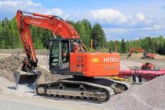 Grävskopa för crawlsimmare för Hitachi Zaxis 225 USRL på konstruktionsplatsen royaltyfria bilder