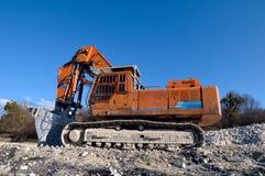 grävskopa Konstruktion och brytamaskineri Arkivfoto