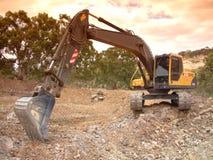 Grävskopa på arbete arkivfoto