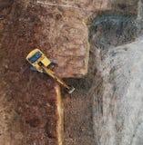 Grävskopa på konstruktionslokalen arkivbild