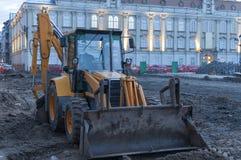 Grävskopa på konstruktionsplats Arkivbild