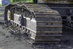 Grävskopa Tracks Arkivfoton
