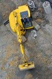 Grävskopagrävare i konstruktionsplats Arkivfoto