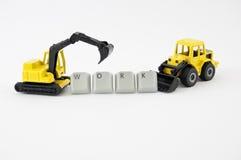 Grävskopan och bulldozern leker med ordarbete Royaltyfri Fotografi