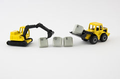 Grävskopan och bulldozern leker med ordarbete Royaltyfri Foto