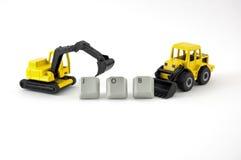 Grävskopan och bulldozern leker med ordjobb Arkivbild