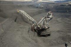 Grävskopan på coalfacen Royaltyfri Fotografi