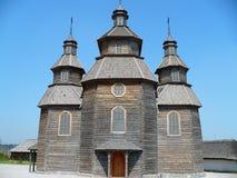 Grå äldst kyrka i Ukraina på våren Royaltyfri Bild