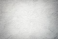 Grå bakgrund av betongväggen som kalkar, abc-bok som är gammal, gru Royaltyfri Foto