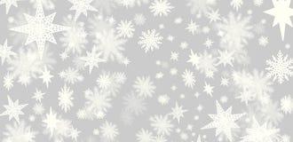 Grå bakgrund för jul med lotter av snöflingor och stjärnor w arkivfoto