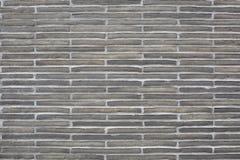 Grå bakgrund för textur för stentegelstenvägg Arkivbild
