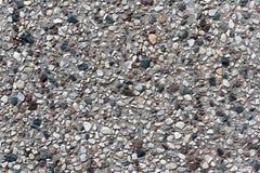 Grå betongvägg med stenar bakgrund och textur Royaltyfria Bilder