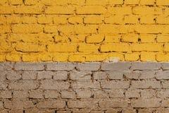 Grå färg-guling tegelstenvägg Royaltyfri Bild