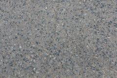Grå färgbetong - asfaltyttersida med Little Rockar royaltyfri bild