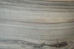 Grå färger marmorerar bakgrund med mörka och ljusa band royaltyfri foto