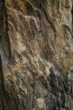 Grå färger och guling vaggar textur Abstrakt bakgrund av stenen Royaltyfri Foto