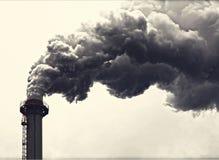 Grå färger som röker industriella två lampglas Arkivfoto