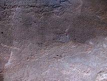 Grå färger stads- gammal cementvägg royaltyfria foton