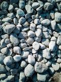 Grå färger stenar bakgrund och textur royaltyfri fotografi