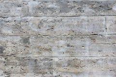 Grå färger texturerad vägg av tegelstenar Arkivfoton