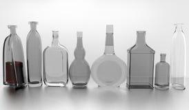 Grå färgflaskor i rad Arkivfoto