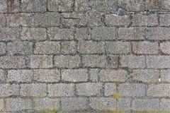grå gammal vägg för tegelsten Arkivbild