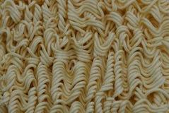 Grå gul textur av torr liten pasta arkivbild