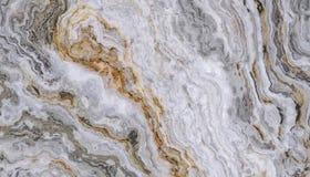 Grå guld- lockig marmor Royaltyfri Foto