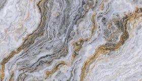 Grå guld- lockig marmor Arkivfoton