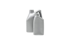 Grå kanister med motorolja som isoleras på vit bakgrund Fotografering för Bildbyråer