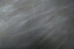 Grå metallbakgrund med blått- och vitfläckar Arkivbild