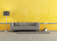 Grå och gul vardagsrum