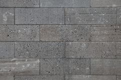Grå ren tegelstenbetongväggbakgrund arkivbild