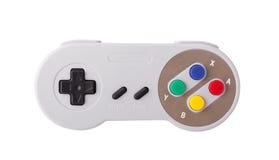 Grå retro styrspak på en vit bakgrund Videospelkonsol GamePad på en vit bakgrund Isolerat på vit Royaltyfria Bilder