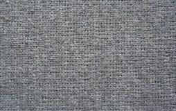 grå stucken textur för tyg Arkivfoto