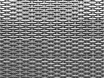 Grå texturerad bakgrund av modern plast- flätverkkorgarbete royaltyfri fotografi