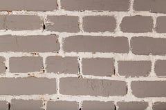 grå texturerad vägg för bakgrundstegelsten Arkivbilder