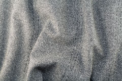 grå ungefärlig textur för bomullstyg Arkivbilder