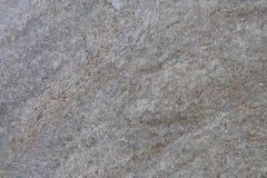 Grå yttersida av granitstenen Royaltyfria Bilder