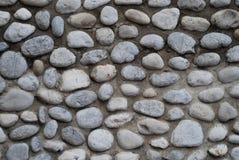 Gråa bakgrunder för stenvägg Arkivbild