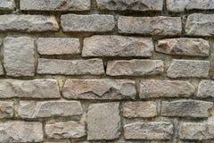 Gråa gamla detaljer för stenvägg royaltyfri foto