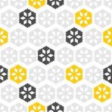 Gråa gula snöflingor på vit Royaltyfri Bild