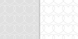 Gråa och vita hjärtor som sömlösa modeller Uppsättning av romantiska bakgrunder Arkivbilder