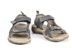 Gråa sandals på vit bakgrund. Royaltyfri Fotografi