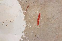 Grådaskig betongvägg som gör en abstrakt bakgrund Fläckar av Royaltyfri Fotografi