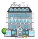 Grått hus med en dekor Arkivbilder