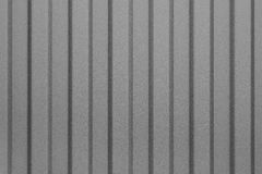 Grått korrugerat ark av metall Modell abstrakt bakgrund Arkivbild