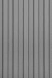 Grått korrugerat ark av metall Modell abstrakt bakgrund Arkivfoton