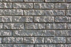 Grått murverk som används i konstruktionen av ett stenhus T royaltyfria bilder